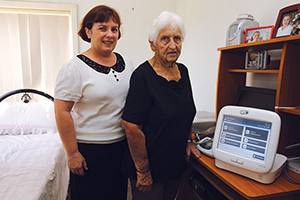 Nurse Anne Maree Battersby with Catherine Bradley using the Intel Health Guide remote patient monitoring system