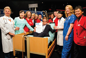 Nurses from France, Korea, United States (NNU), Ireland, England, and Australia pose with Bill Nighy at the G20 meeting.