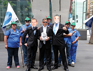 NSWNMA Nurses stand strong on Robin Hood Tax pictured wAbbott & Hockey